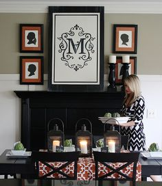 via The Yellow Cape Cod    love the monogram and black fireplace...so striking!