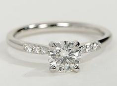 Blue Nile - platinum engagement ring accented with pavé-set diamonds along the shank.