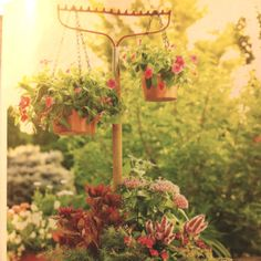 Use an antique garden rake to hang little pots from in the garden or a potted plant.