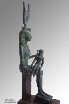 Queen Isis as Isis nursing Thutmose III, Period:  Egypt, New Kingdom, Dynasty 18, Thutmose II/Aakheperenre   Dating:  1512 BC–1504 BC   Origin:  Egypt, Upper Egypt, Thebes   Material:  Bronze
