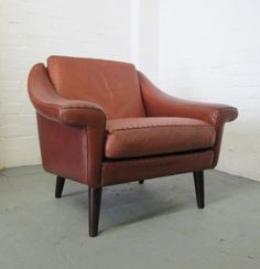 Mid-century Danish red leather armchair with stitch detail