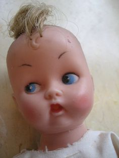 1950's baby doll with a little tuft of hair. From rudysroundup.