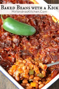 Baked Beans with a Kick - sweet and spicy, full of flavor, and covered with bacon; friends have called these the best baked beans they have ever had! : mirlandraskitchen