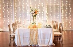 I like this string lighting behind sheer curtains! Unique Lighting Ideas Wedding Reception Photos on WeddingWire