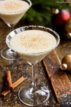 This warmly spiced drink, Angela's Eggnog Cocktail, is a holiday crowd pleaser. It's a great beverage to whirl up some end of evening excitement and flair! This cocktail is ultra cold and creamy, and warmly spiced - a holiday crowd pleaser! Eggnog Cocktail, Spiked Eggnog, Cocktail Recipes, Cocktail Drinks, Eggnog Drinks, Drink Recipes, Milk Shakes, Christmas Cocktails, Holiday Cocktails