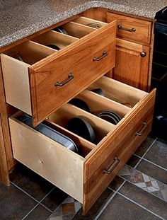vertical baking pan storage- must have in next house- so practical!