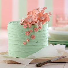 Pink Blossom Bouquet Cake - A floral topper adds an elegant touch to this springtime cake. Use the Gum Paste Flower Cutter Set to craft these delicate flowers with ready-to-use Gum Paste. Wilton classes will guide you in the fine art of flower making.