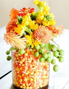 October weddings get a fun and flirty table centerpiece with designs that incorporate candycorn.