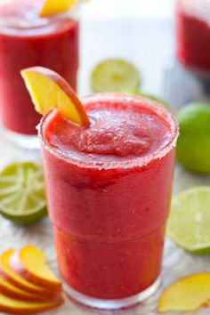 This spiked slushie recipe will help you celebrate the weekend with a refreshing combo of peaches, raspberries, limes, coconut sugar, tequila and triple sec. Click through for more wine slushie recipes to try this summer. Sangria Recipes, Cocktail Recipes, Wine Recipes, Cooking Recipes, Watermelon Recipes, Cocktail Menu, Milkshake Recipes, Vodka Slushies, Wine Slushie Recipe