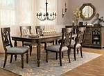"""If you're searching for a dining set with the looks your friends will rave about and the comfort they'll stick around for, you'll love the Kasari. This 5-piece dining set has it all, from the beautiful oak finish to fine details like nailhead trim and turned legs. Four dining chairs with scroll-back woodwork provide stylish seating, and an 18"""" leaf allows you to extend the table's length to accommodate your guests."""