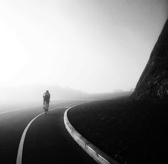 Cyclist in the mist