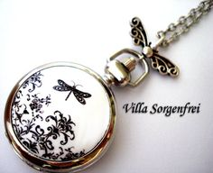 Dragonfly Silhouette - enameled romantic pocket watch necklace by Villa Sorgenfrei. $23.90, via Etsy.