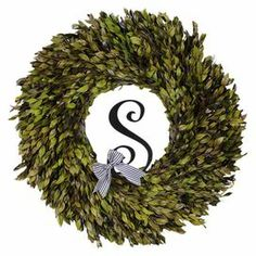 """Preserved myrtle wreath with a black and white striped ribbon and a letter """"S"""" accent.  Product: Preserved  wreathConstruction Material: Silicone, natural twigs and ribbonColor: GreenFeatures: Includes preserved myrtleDimensions: 22"""" Diameter x 5"""" D Cleaning and Care: Wipe gently with a dry cloth"""