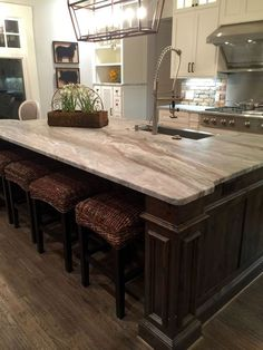 Veined white granite- the look of marble and the durability and ease on
