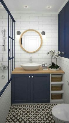Scandi bathroom with dark blue colour accent and patterned floor tiles