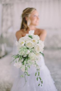 white wedding bouquet of orchids, tulips and roses // charlene schreuder photography