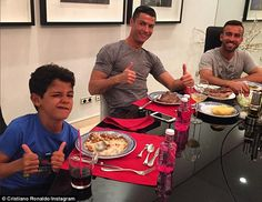 The ex-Manchester United star pictured with his son Cristiano Ronaldo Jnr (left) and friend Ricardo Regufe