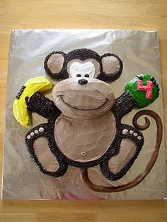 idea for monkey cake - a bit more involved, but really cute! @Jessica Hill this would be cute for kaylas shower :)