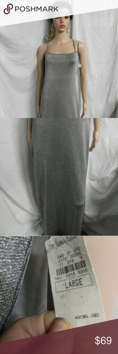 Silver Shelli Segal large eve dress neiman This is a beautiful long dress by laundry. It is silver and has some stretch to it. My mannequin is a size 5 do I had to pin the straps in back.It has the tags and it was 235 dollars.Brand new and never worn.I have the beautiful chandelier earrings that she is wearing.They we're created by myself.Pamela May. Shelli Seagal by Laundry Dresses Maxi
