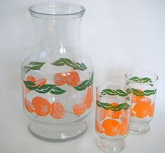 Yep! We had this pitcher when I was a kid. I don't remember the glasses though. Vintage Juice Pitcher - Glass pitcher, oranges and leaves, 2 matching drinking glasses. $32.89, via Etsy.