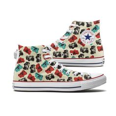 Camera Converse High Top chucks are here and made to order especially for you. These Chucks feature a unique Camera scatter pattern over both panels of the shoe. Each pair is custom-made so color and