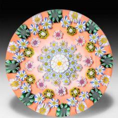 Drew Ebelhare 2015 patterned millefiori flower canes on orange ground paperweight. by Drew Ebelhare