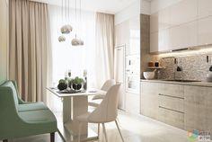 Цветовая гамма кухни выдержана в общем стиле со всем интерьером квартиры - бежевый и белый. Фасады кухонной мебели изготовлены из мдф, фасады верхних ящиков - глянцевые. В кухне есть все необходимое для приготовления вкусной пищи.