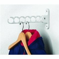 """Spectrum 35000 Hanger Holder by Spectrum. $6.06. The unique """"circle"""" design allows multiple hangers in each loop at all times - Great for small laundry rooms. Size: 11 3/4"""" H x 2 """" W x 1 1/4"""" D. Store shirts and pants, or hang wet clothing items to air dry while keeping them wrinkle-free. Unique design allows the arm to fold away when not in use for added storage space. Provides valuable hanging space for ties, belts, and garments on hangers. Conveniently folds up and down f..."""