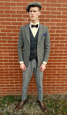 Straight-on view of the suit. Even with the jacket unbuttoned, note the extremely slender fit of the suit. As the baggy Sack Suits of the Edwardian Era gave way to the extremely slender designs of the late 1910's and 1920's, these suits gained more and more popularity, especially among the less-Conservative crowd, many of whom had recently returned home from the Great War.
