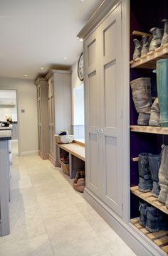 bespoke fitted bootroom with grey finish and large cupboards by lewis alderson