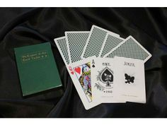 Black Luxury Expert at the Card Table Playing Cards