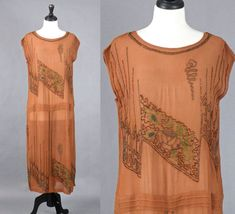 Vintage 1920s Beaded Dress, 20s Flapper Dress, Brown Silk Crepe Floral Beaded Roaring 20s Dress by daisyandstella on Etsy https://www.etsy.com/listing/555348980/vintage-1920s-beaded-dress-20s-flapper