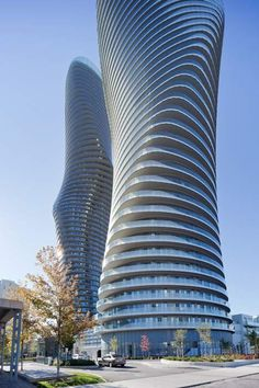 Chinese firm MAD has completed a pair of curvaceous twisted skyscrapers in the growing city of Mississauga, Canada
