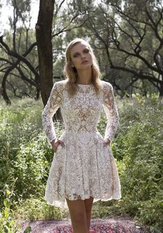 Do YOU dare to bare? Then the Kylie short wedding dress could be perfect for you, featuring a playful lace skirt, traditional sleeves and a scooped back. Introducing the Limor Rosen Wedding Dress 'Birds of Paradise' 2017 Collection, ideal For Bohemian Brides. Check out all the wedding dresses on Wedding Ideas