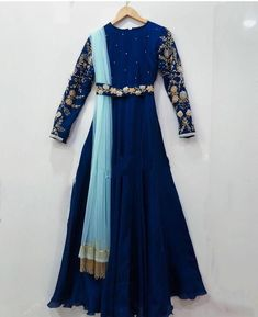 Grab this stunning dress now. Beautiful royal blue color floor length dress with ice blue color dupatta. Dress with waist belt. Dress with floral design hand embroidery work on sleeves. Long Gown Dress, Anarkali Dress, Designer Anarkali, Stunning Dresses, Stylish Dresses, Fashion Dresses, Indian Attire, Indian Outfits, Indian Designer Outfits