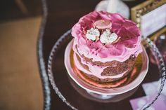 naked cake with pink icing, photo by Jesus Caballero http://ruffledblog.com/second-anniversary-photoshoot-with-cotton #weddingcake #cakes