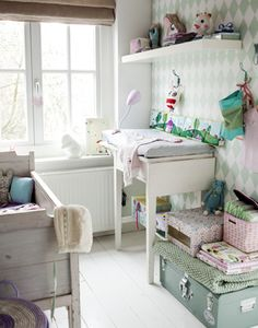 This vintage nursery in mint green uses a fresh, new wallpaper to nicely offset the antiques.