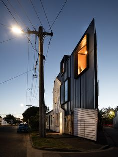 acute house responds to a challenging triangular site and run-down building where the outcome is a multi leveled and distinctive dwelling.