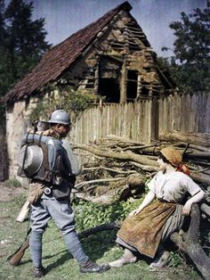 Autochrome of a French soldier speaking with a French peasant woman, c. 1917.