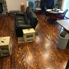 Pine plywood that we cut in 8 inch width strips, sanded, routered edges, and used liquid nails and nailed to sub floor. Then stained followed by sanding between 3 coats of polyurethane. A ton of work but cost about $1.00 a square foot. We love our new floor!