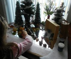 Nature Table- a forest on a mirror for a frozen pond!