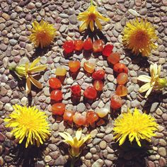 Ceremony can be very simple. Here, a summer solstice ritual where I used marigolds and carnelian stone to welcome the longest day of the year. I then used the stones to make a bracelet. www.sagegoddess.com