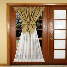 If you are going to have a curtain on a french door... it should be this cute.. but a better color