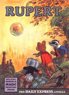 Rupert the Bear.  My Uncle Morris used to buy one of these for my brother each year. :)