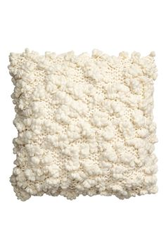 Natural white. Cotton cushion cover with a chunky-knit, textured front. Woven cotton fabric at back. Concealed zip.