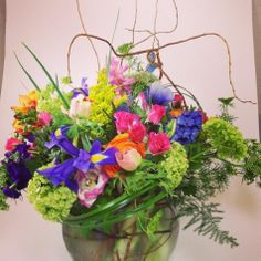 Wild Flower centerpiece. Curly willow, iris, queen anne's Lace, Bright colors, Fun centerpiece