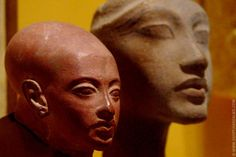 Akhenaten (1353–1336 BC or 1351–1334 BC) and one of his daughters.