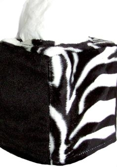 Faux-Fur Ebony (black), Zebra Tissue Covers. Zebra print top, alternating ebony Zebra print sides. Slips over your tissue box.  Machine washable.  100% Polyester.      Vertical Cover, fits over standard tissue box.   $18.00 SALE $12.00
