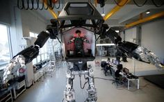 An-employee-controls-the-arms-of-a-manned-biped-walking-robot-METHOD-2.jpg (720×450)