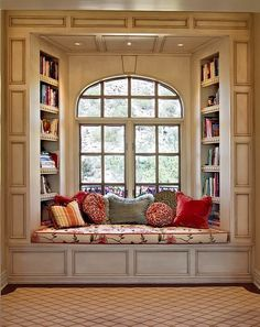Something similar but move the bookshelves on to the walls flanking the window, so you get more light in